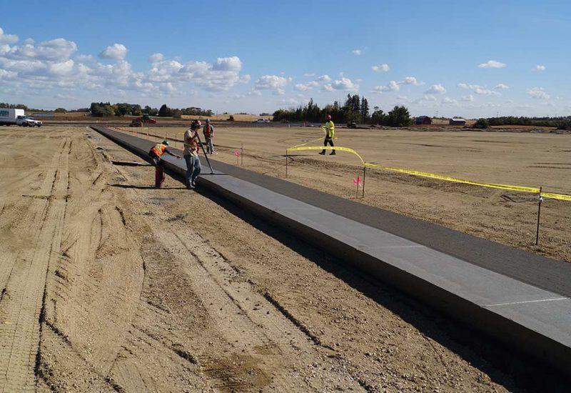 Crew leveling new concrete sidewalk edmonton