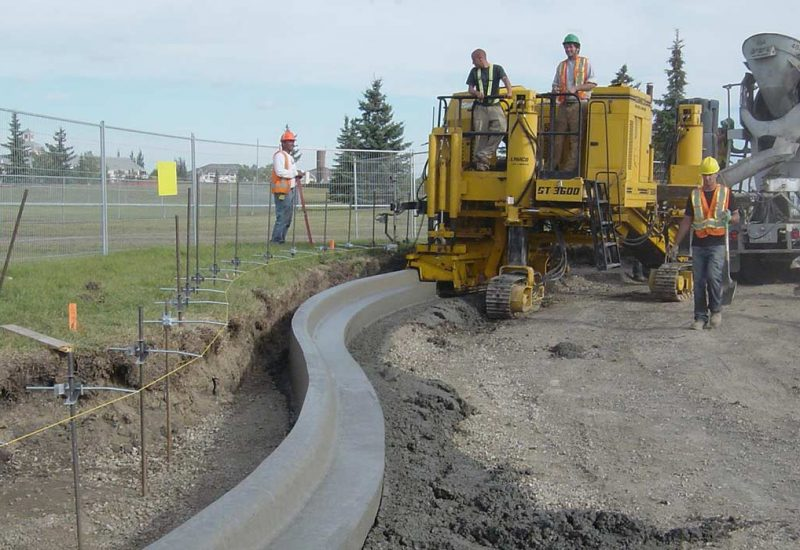 Crew completing residential curb in edmonton
